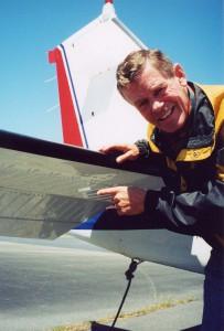 Bob Unser showing his Beechcraft B36TC Bonanza with Micro VGs on horizontal stabilizer.