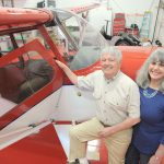 Charles White and Anni Brogan standing besides Aeronca 7AC with Micro Vortex Generators installed.